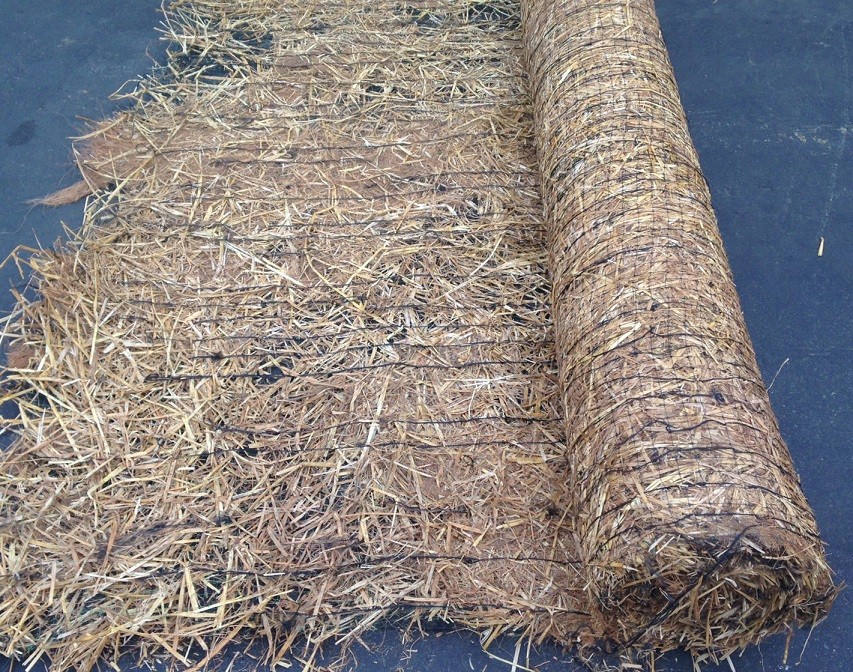 Straw Coconut Blanket Rolled Left